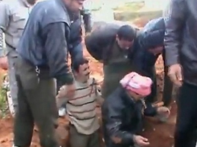 Digging graves in Syria.