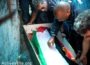 Palestinians stand above the body of Muhammad Abu Khdeir during his funeral. (Activestills/Yotam Ronen)