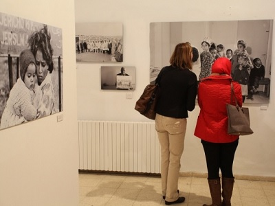 Visitors at the al-Bireh Cultural Centre in Ramallah  at the launch of 'The Long Journey'. (Rich Wiles/MEE)