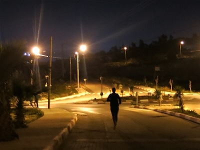 A woman runs in the early evening near Ramallah in the Occupied Palestinian Territory. (Annie Slemrod, IRIN)