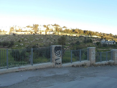 Fence built by Israel 5 years ago dividing ancient road from Wadi Joz to Al Aqsa Mosque.  Land to the East is now off limits to Palestinians.  Amro home is the first home immediately to the West at the intersection with the road that connects Hebrew University Mt . Scopus with Rockefeller museum/Herods gate in the Old City.