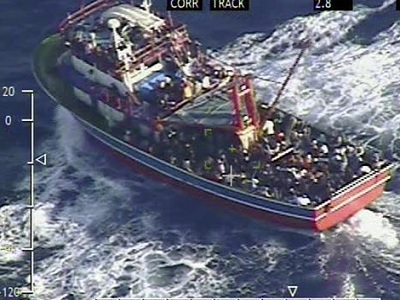 A small vessel loaded with 353 people believed to be refugees fleeing Syria lies around 50 nautical miles southwest of Cyprus' coast in Sept 2014. (Cypriot Defense Ministry)