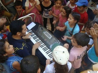 The Piano Man of Yarmouk. (Via Facebook)