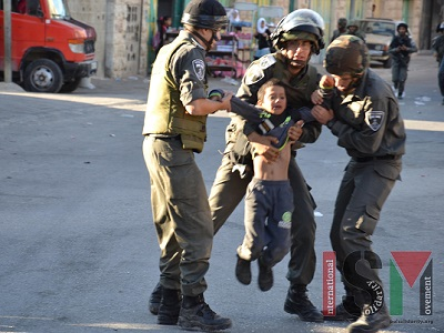 Israeli army arresting a 7-year-old Palestinian child. (ISM, file)