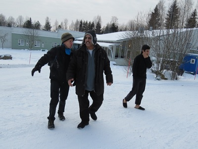 The author, Mohammad and Omar at a Finnish camp for asylum seekers, January 2016. (Hakim, Afghan Peace Volunteers, Supplied.)