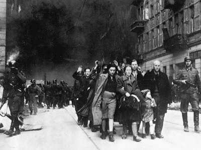 Captured Jews are led by German troops to the assembly point for deportation. (Picture taken at Nowolipie street, near the intersection with Smocza, Wikimedia Commons)