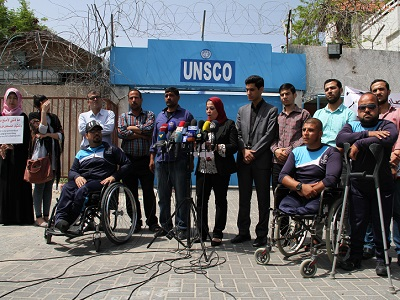 Representatives of civil society reading a statement intended for the Obama Administration from the Gaza headquarters of UNSCO on April 27. (Photo: Abdulkareem, Palestine Chronicle)