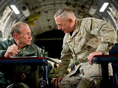 Mattis (R) with General Martin Dempsey on board a C-17 while flying to Baghdad, December 2011. (Photo: DoD, Wikimedia Commons)