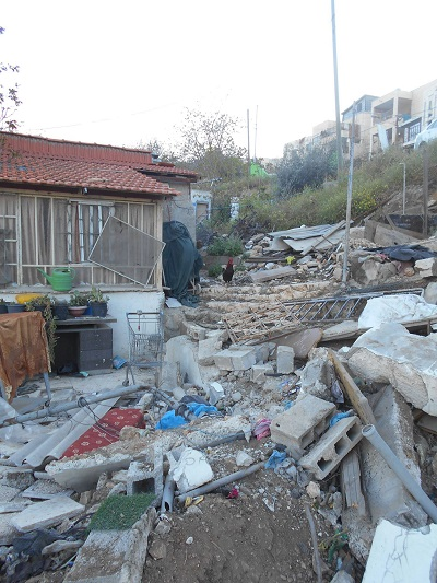 Destroyed Amro home with pile of rubble hiding the evidence.